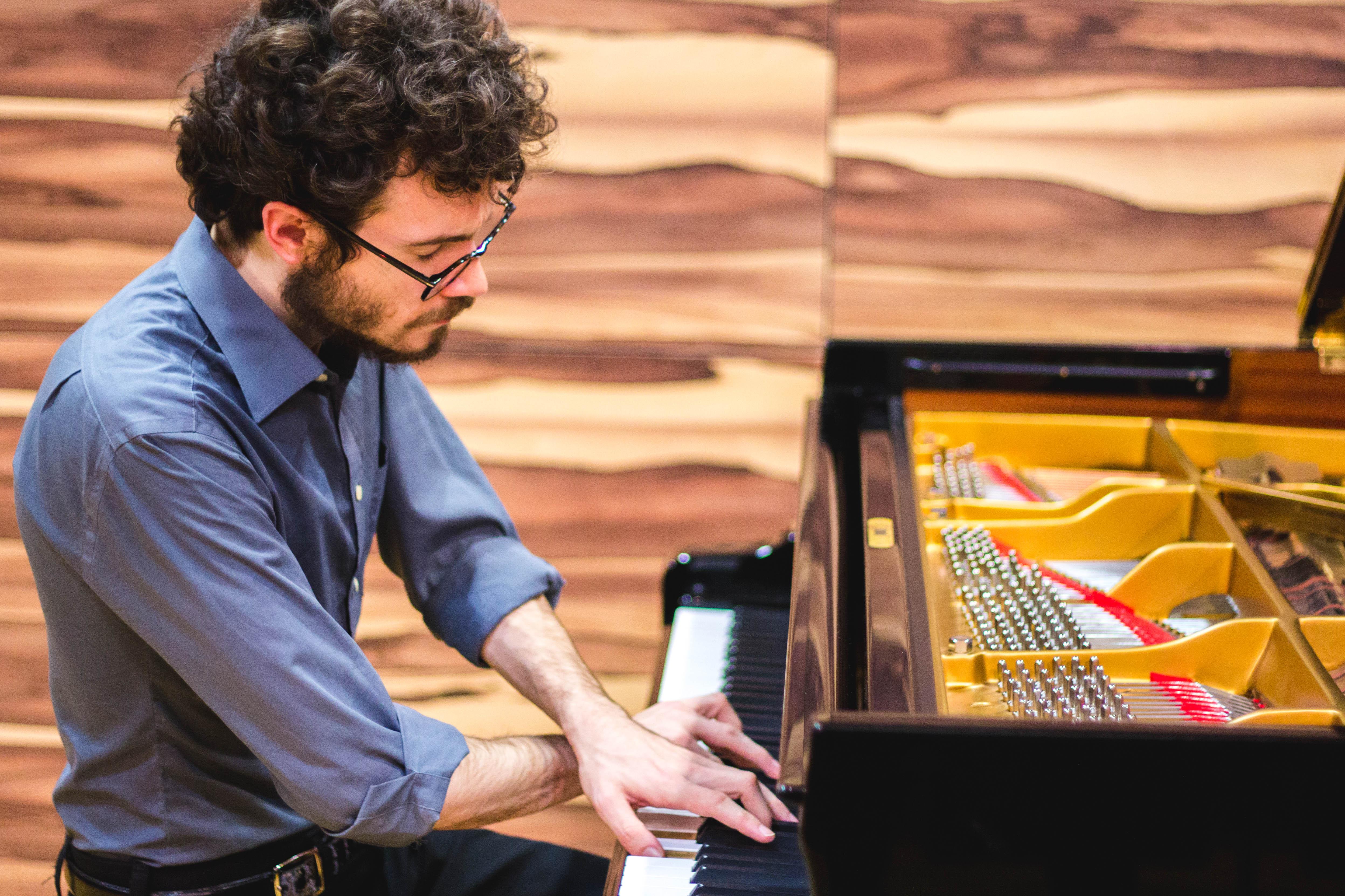 Joshua Rupley crossed hands piano playing klavier