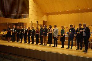 Joshua Rupley receives his Deutschland-Stipendium from Daniel Kown, Seiler and the Würzburg University of Music