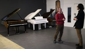 Joshua Rupley and Mr. Feurich standing in the Seiler piano factory in Kitzingen